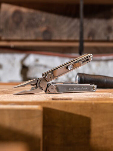 Leatherman Curl on table in workshop