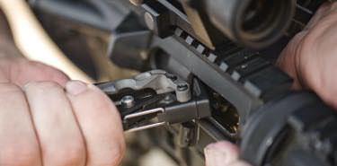 Military member clears jam on AR-15 with Leatherman OHT bolt override tool