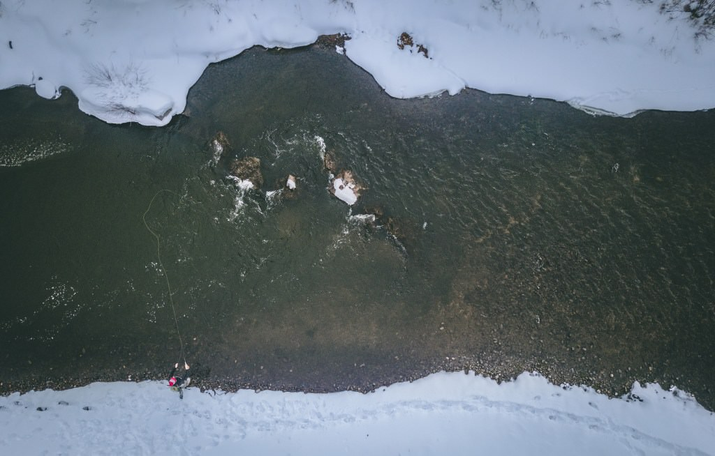 Overhead view of winter fly fishing.