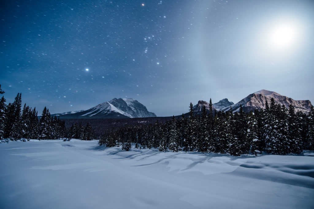 Night time photo of snowy mountains in central Alberta. Temperatures dropped below -30f while photographing this scene.