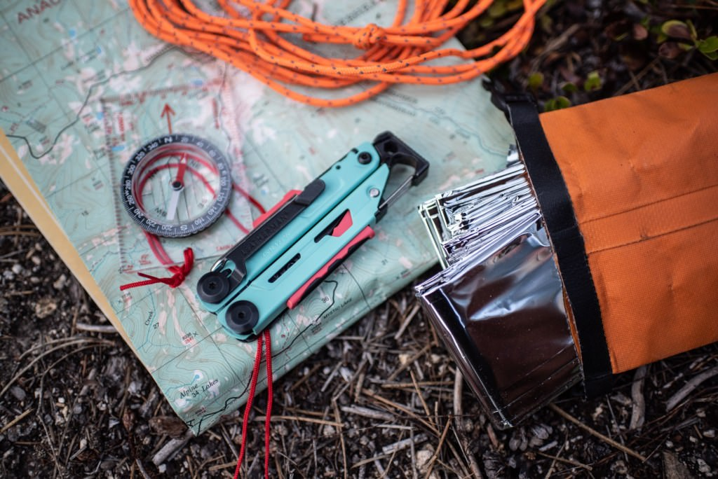 Leatherman Signal, compass, map, roap, and emergency blanket.