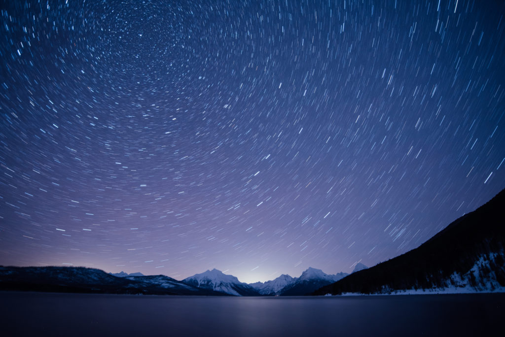 Winter long exposure image of the night sky. Star trails come to life in the Montana sky by utilizing a shutter speed of five minutes.