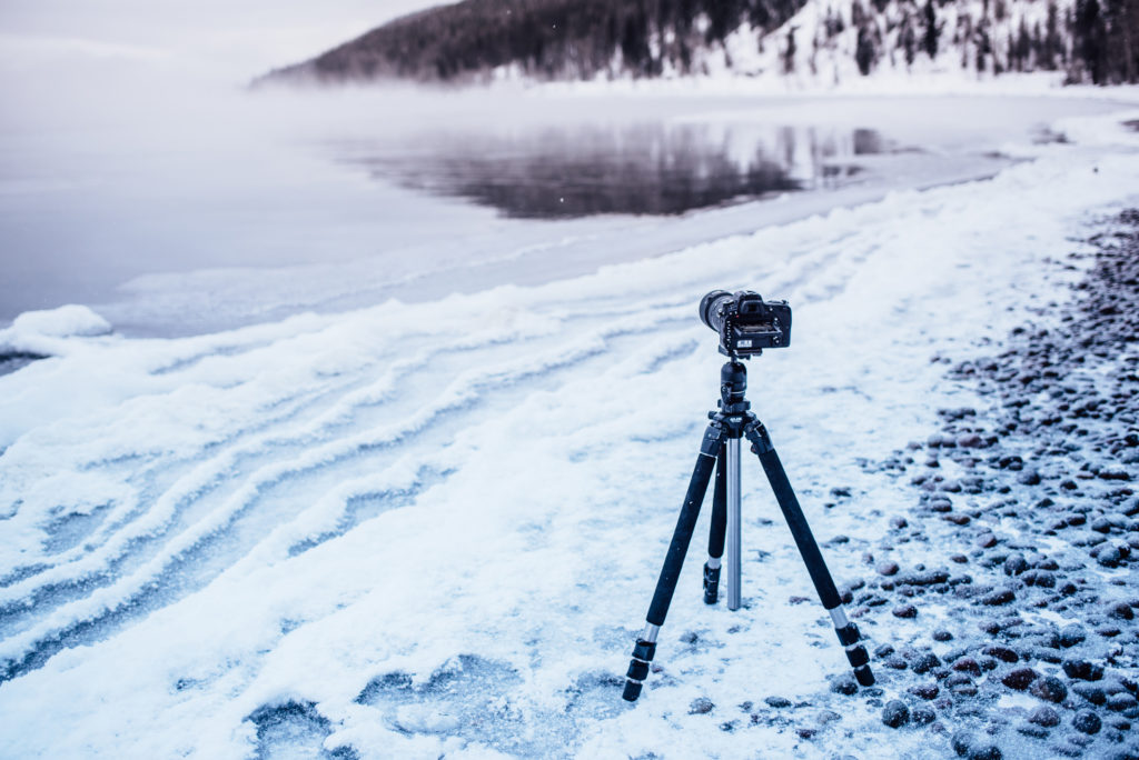 Isaac Miller's camera on a tripod ready to capture a long exposure overlooking a lake in western Montana.