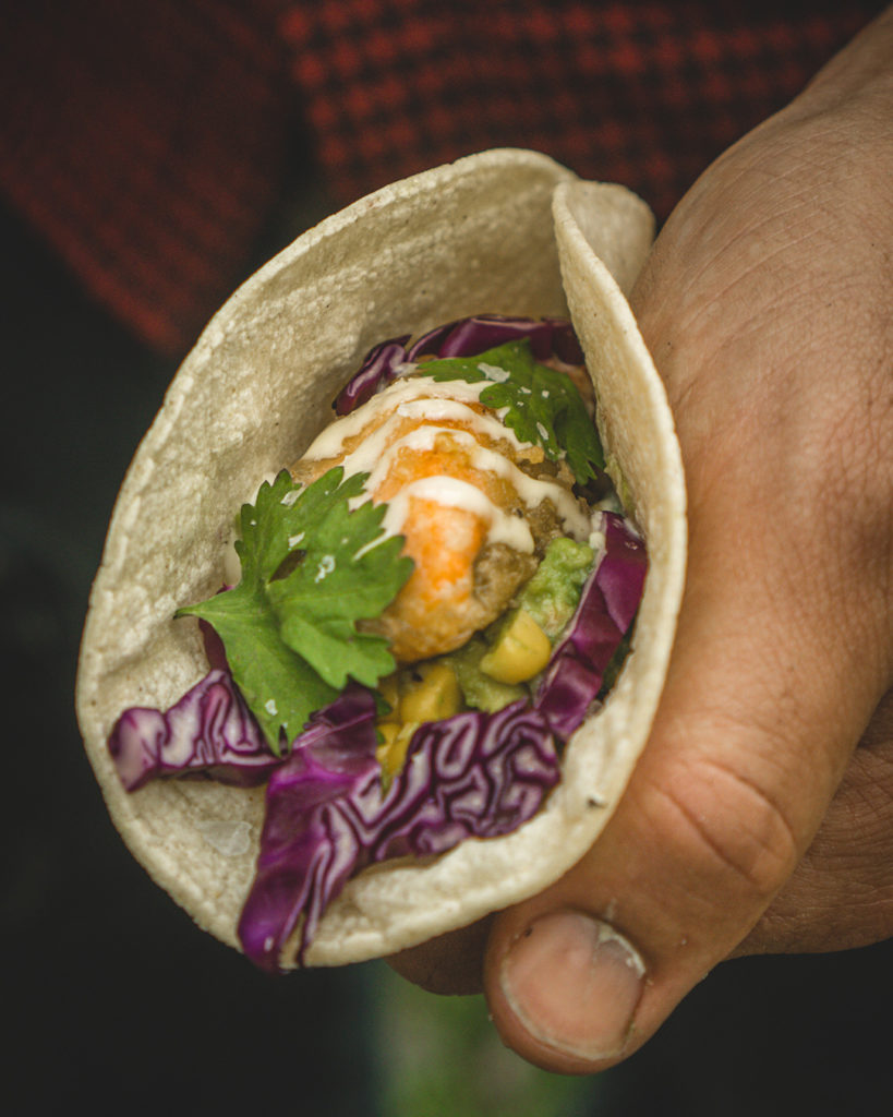 Delicious salmon taco that was cooked on a cast iron pan.