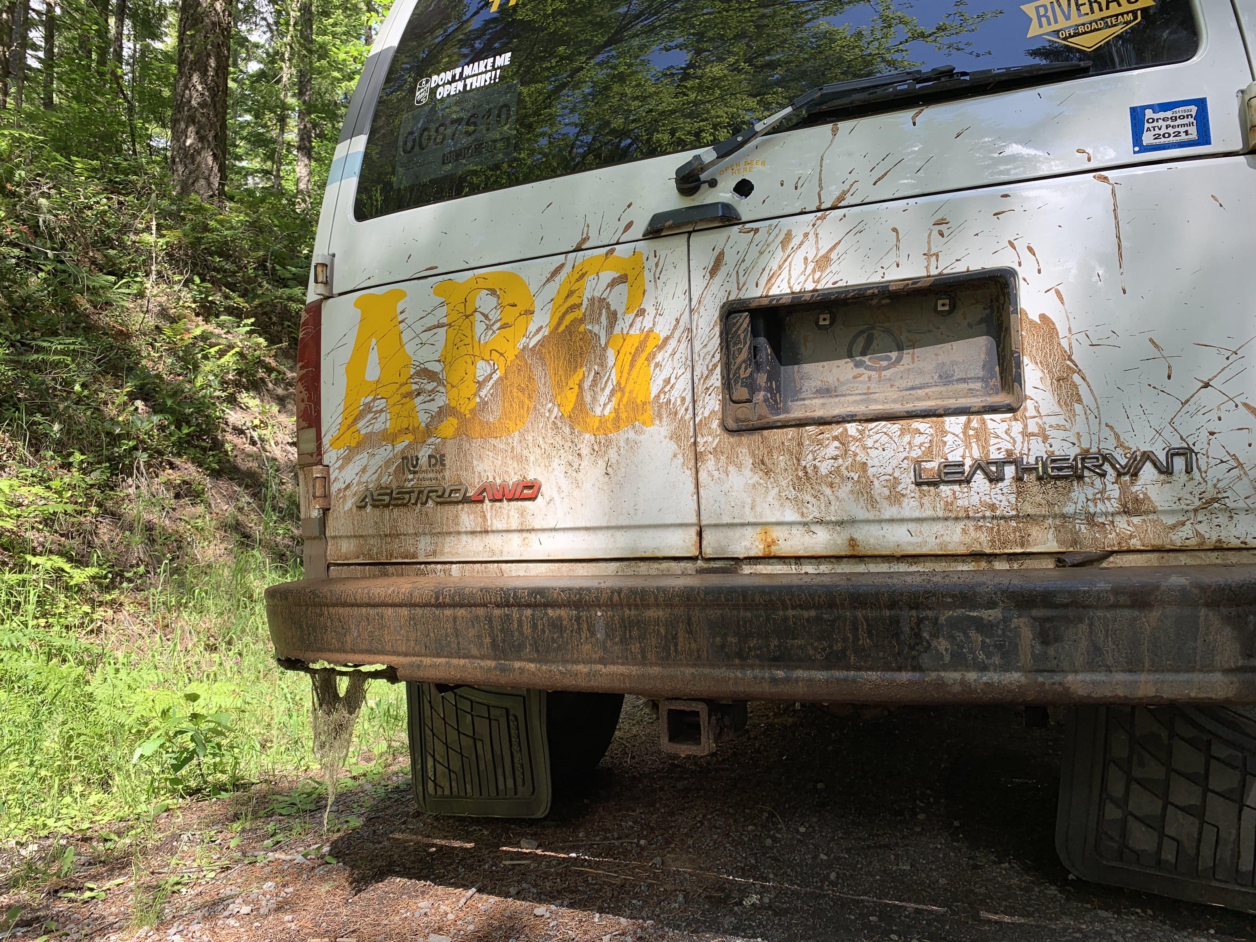 The Leatherman van covered in mud.