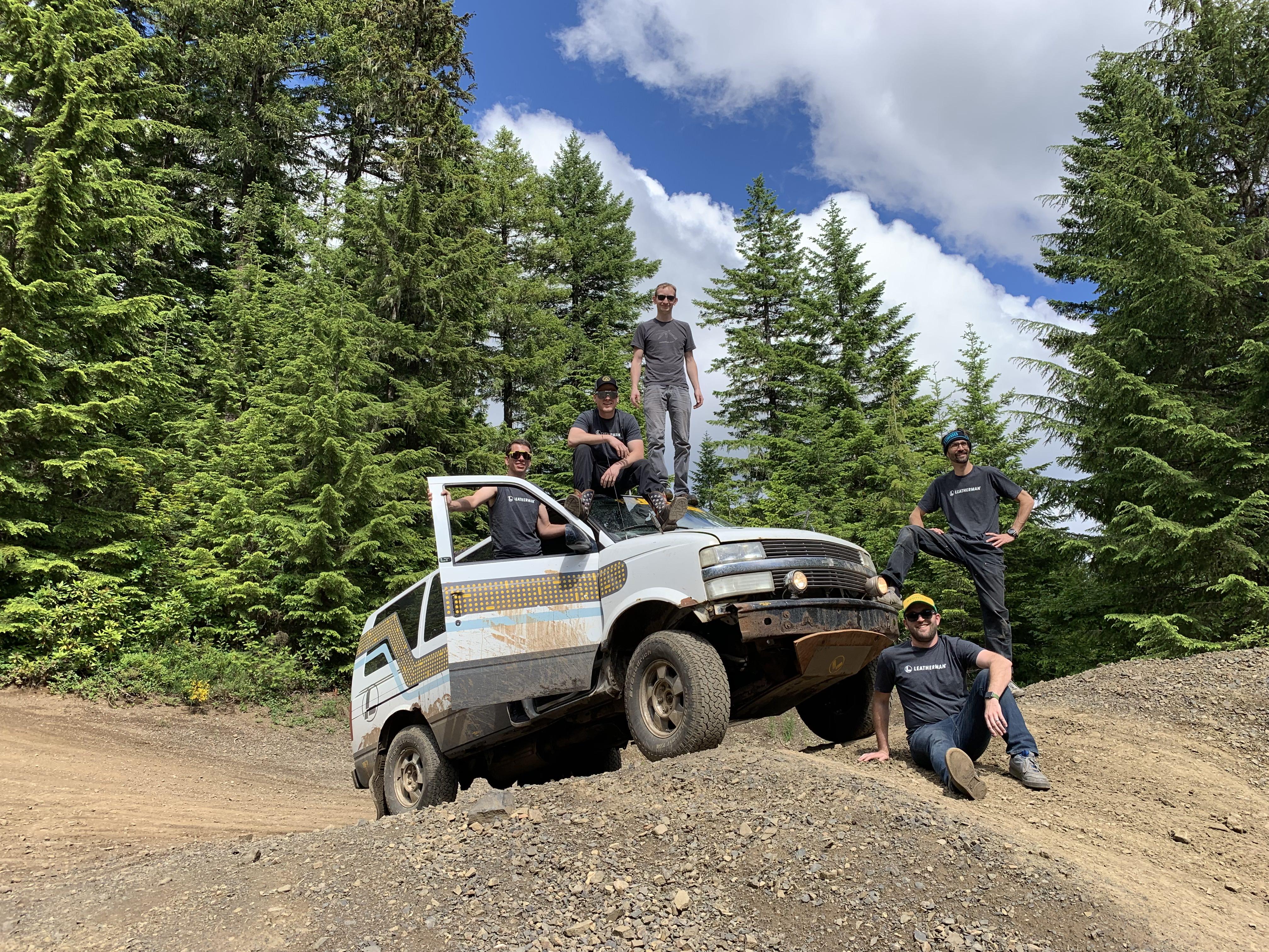 The Leatherman Gambler team standing on top of the van.