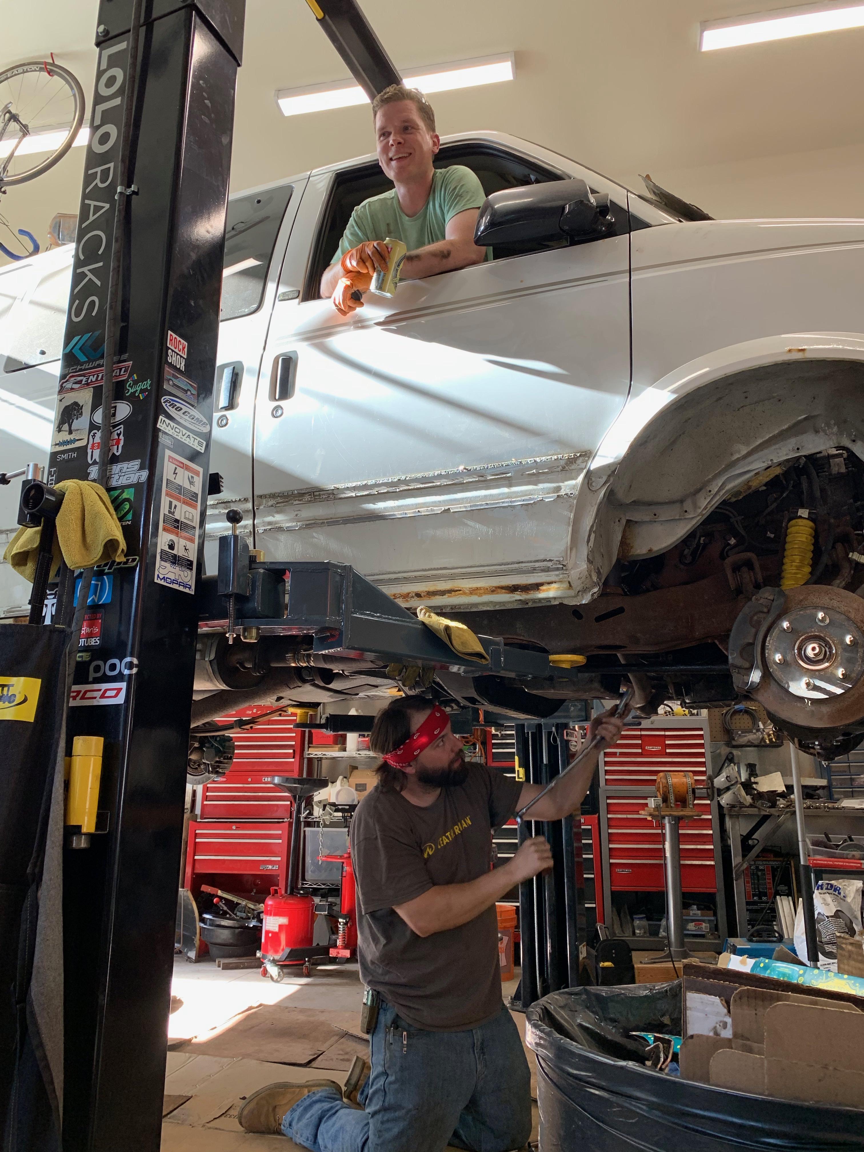 Leatherman engineers working on van.