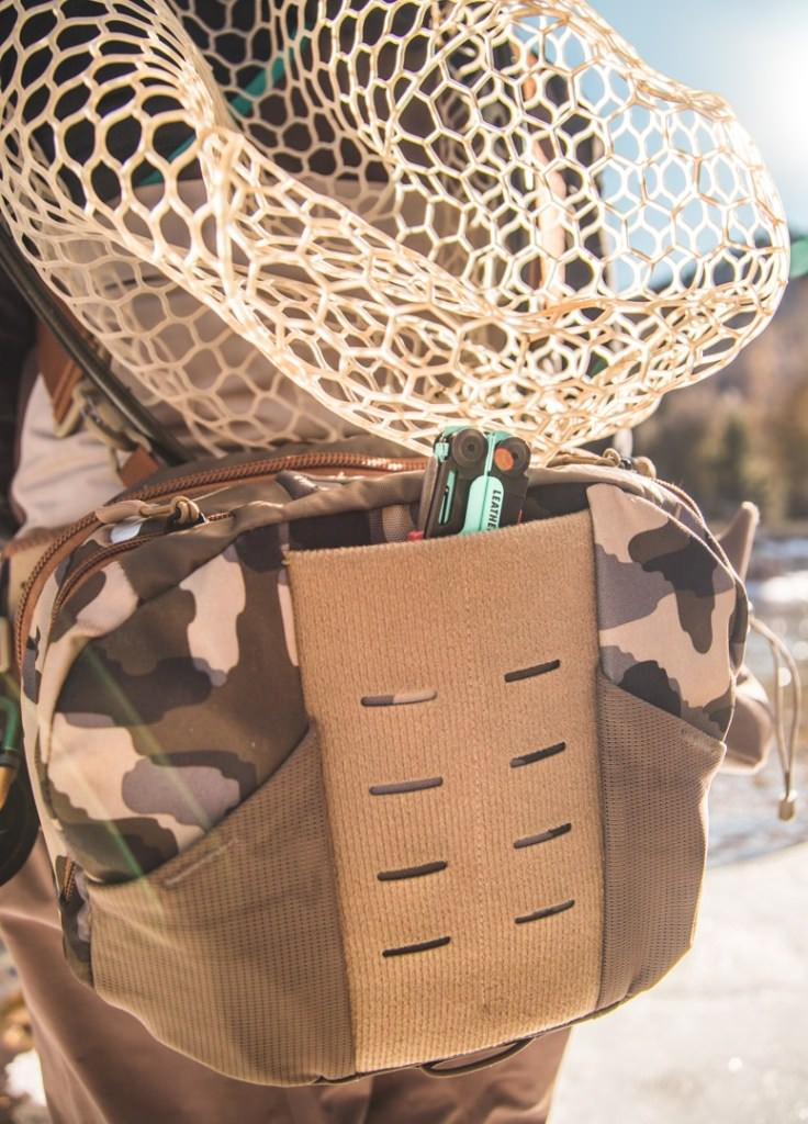 Fishing gear loaded in back pack with a Leatherman Signal.