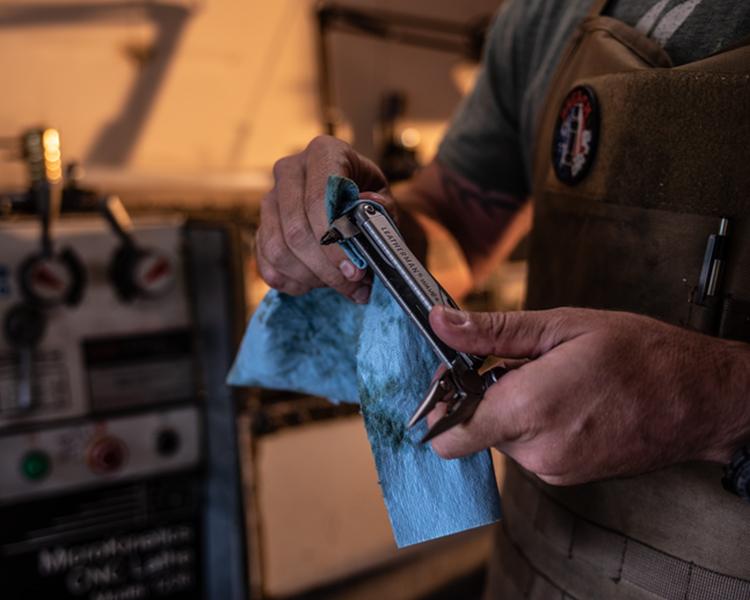 mechanic holding leatherman tool
