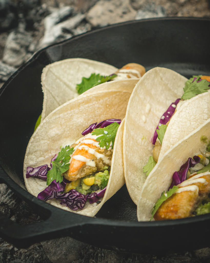 The finished salmon tacos with guacamole, cabbage and special sauce.