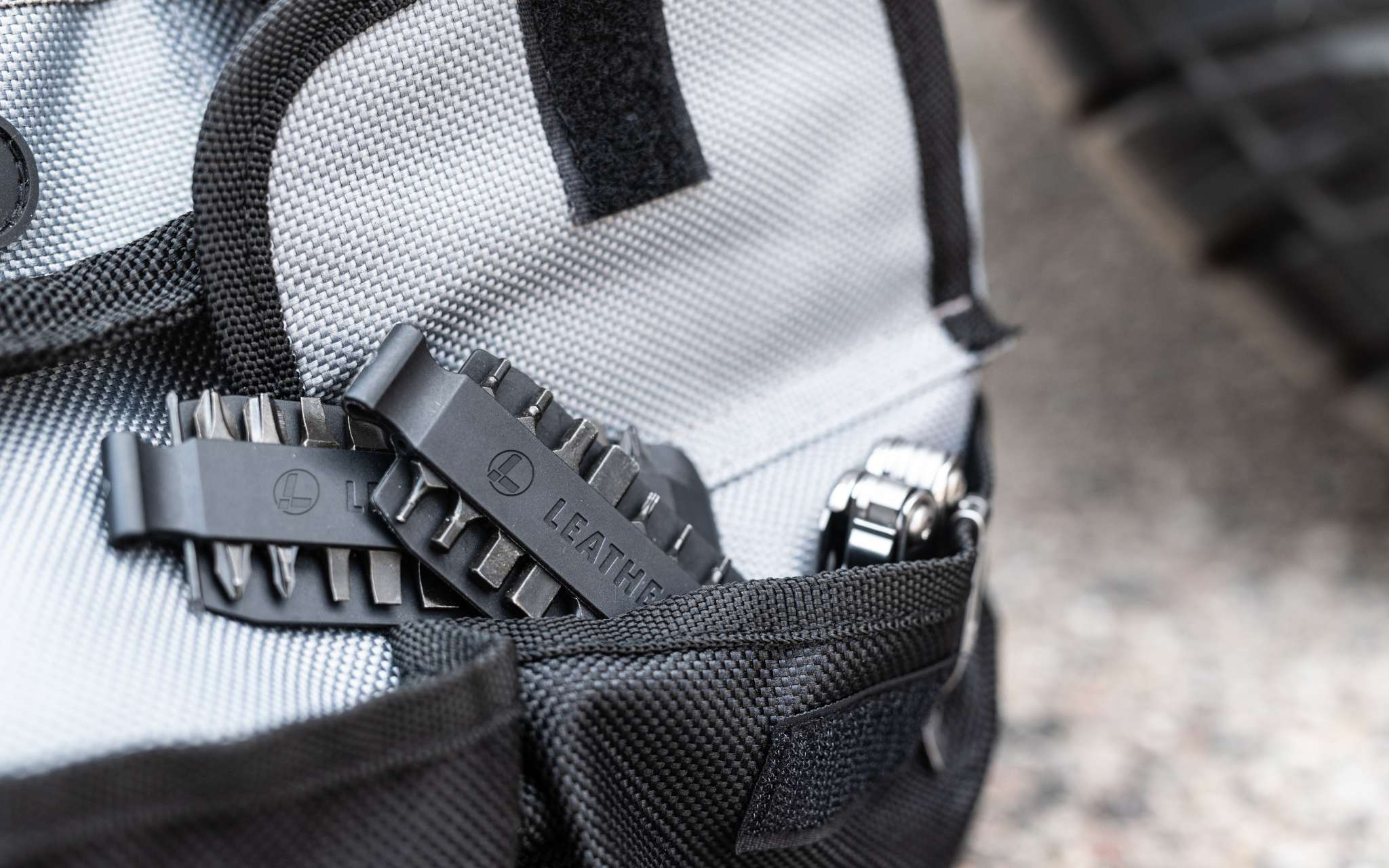 Bit kit and leatherman curl in backpack pocket