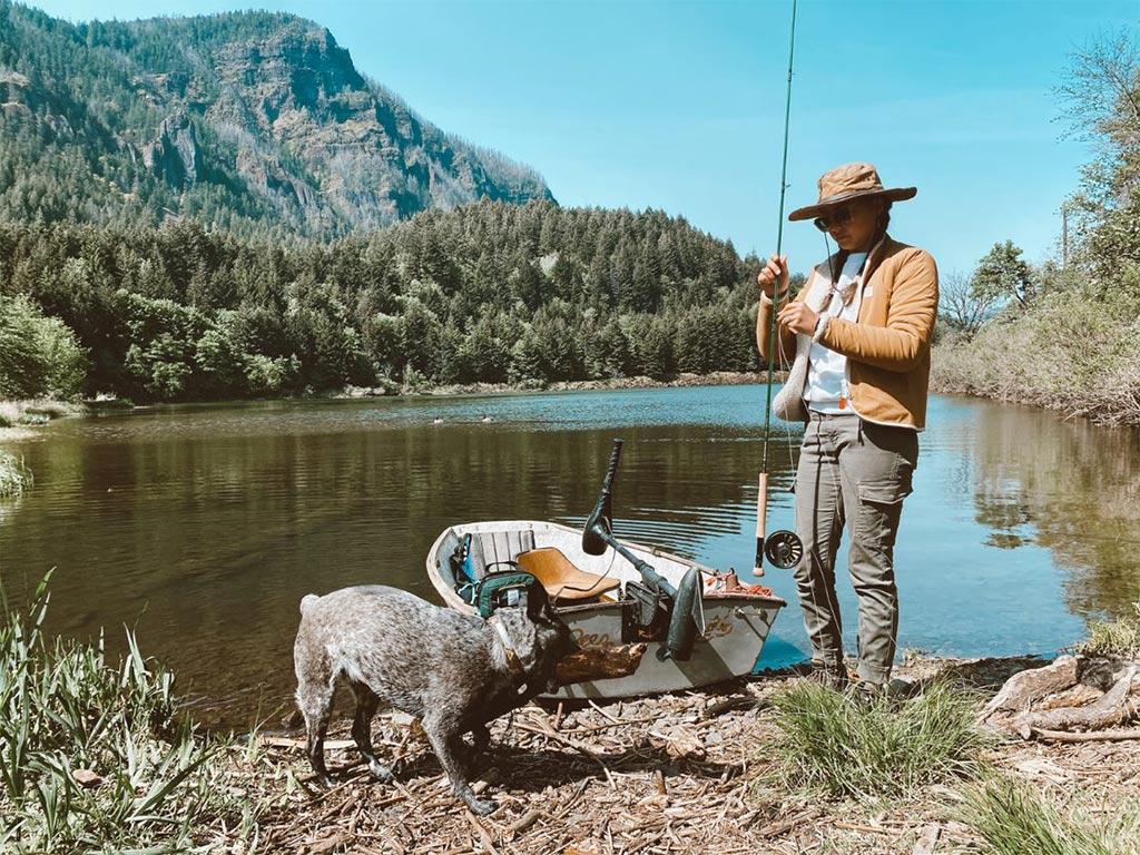 Fishing at a lake with a dog