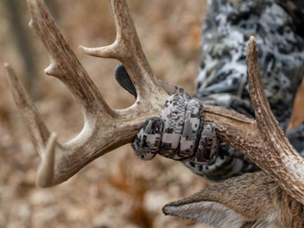 hunter holding deer antlers