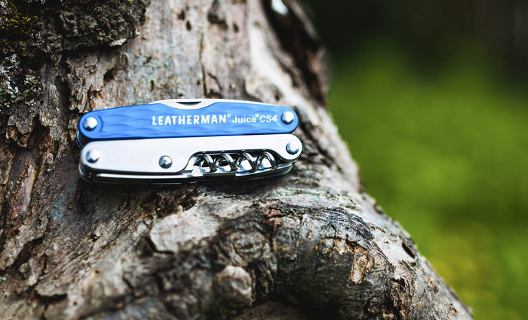 Leatherman blue juice cs4 multi-tool on tree, used in outdoors