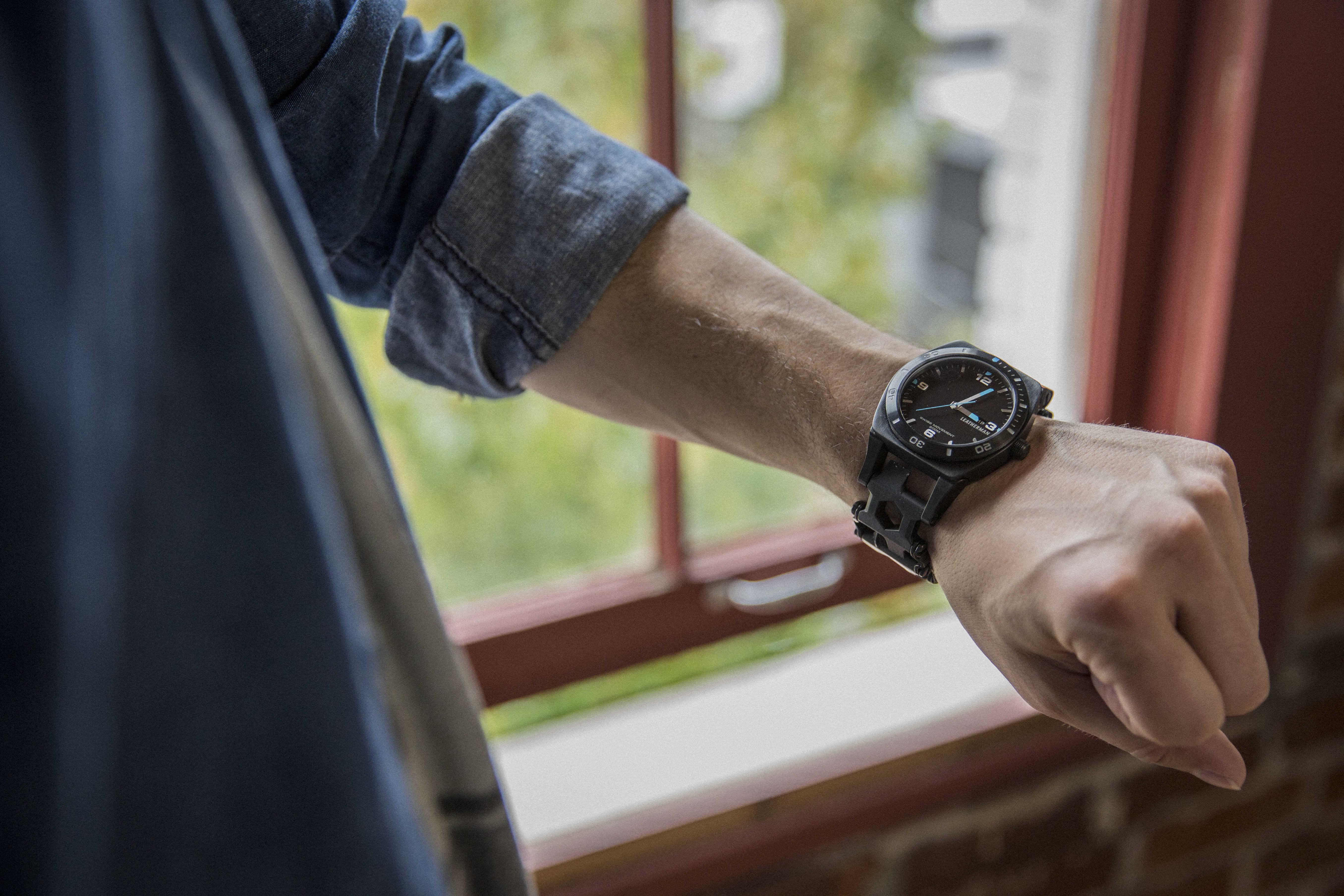 Leatherman tread tempo multi-tool watch on wrist, black