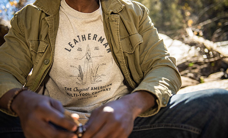 Outdoorsman wears gray Leatherman PST Heritage T-Shirt while camping.
