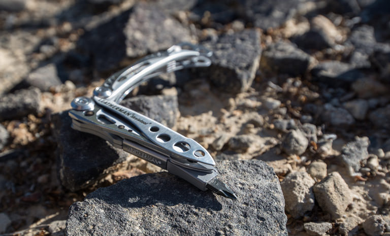 Leatherman stainless steel skeletool multi-tool on bed of rocks