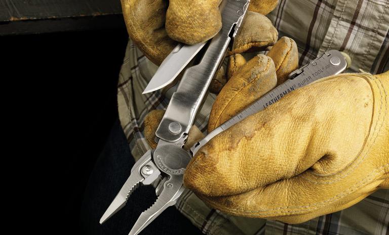Leatherman stainless steel super tool 300 multi-tool in hand