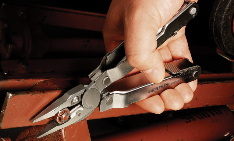 Leatherman stainless steel super tool 300 multi-tool in hand, pliers in use