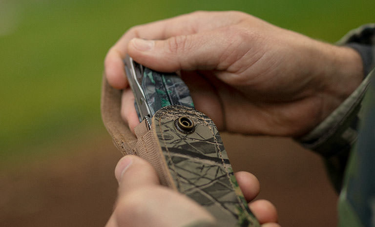 Leatherman Charge TTi multi-tool, Realtree camo print, putting away in camo case