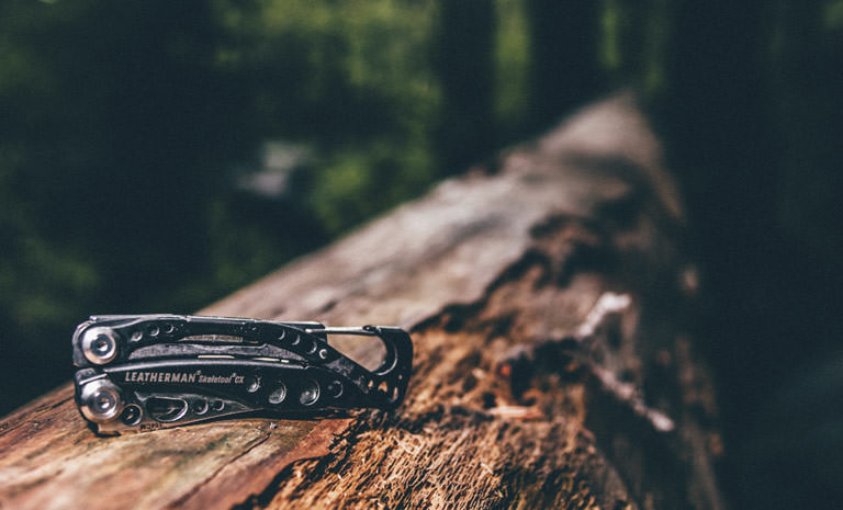 Leatherman skeletool CX on wood, outdoor multi-tool