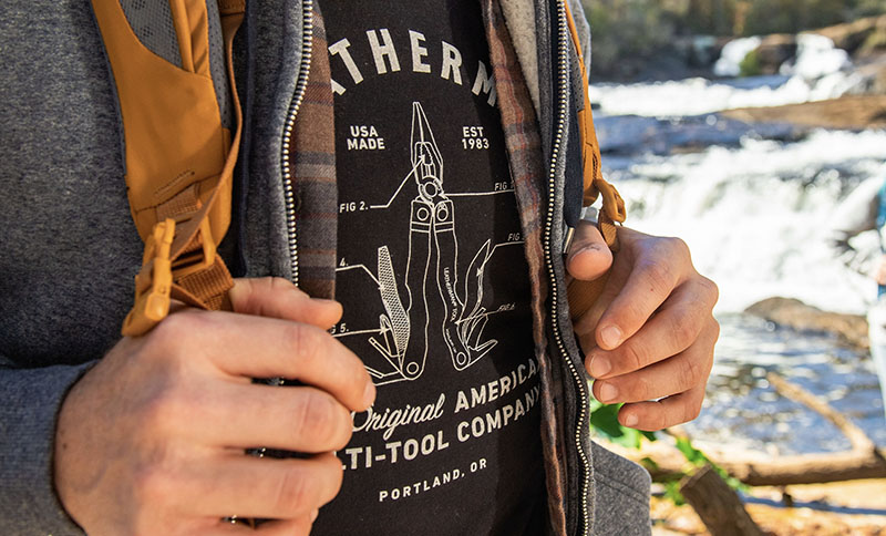 Outdoor enthusiast wears Leatherman PST Heritage Tee in black while hiking.