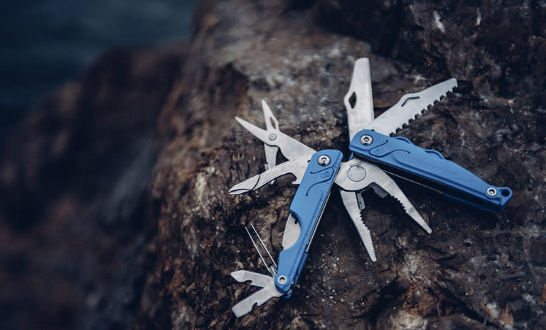 Leatherman blue leap multi-tool on rock, open view, 13 tools