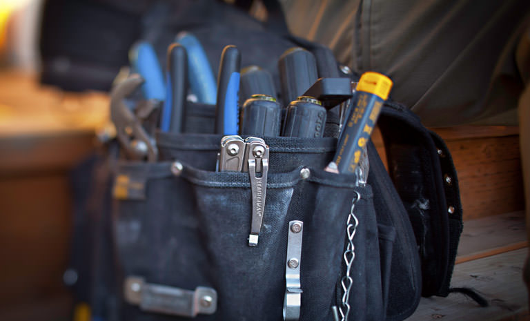 Leatherman stainless steel wingman multi-tool in black tool bag