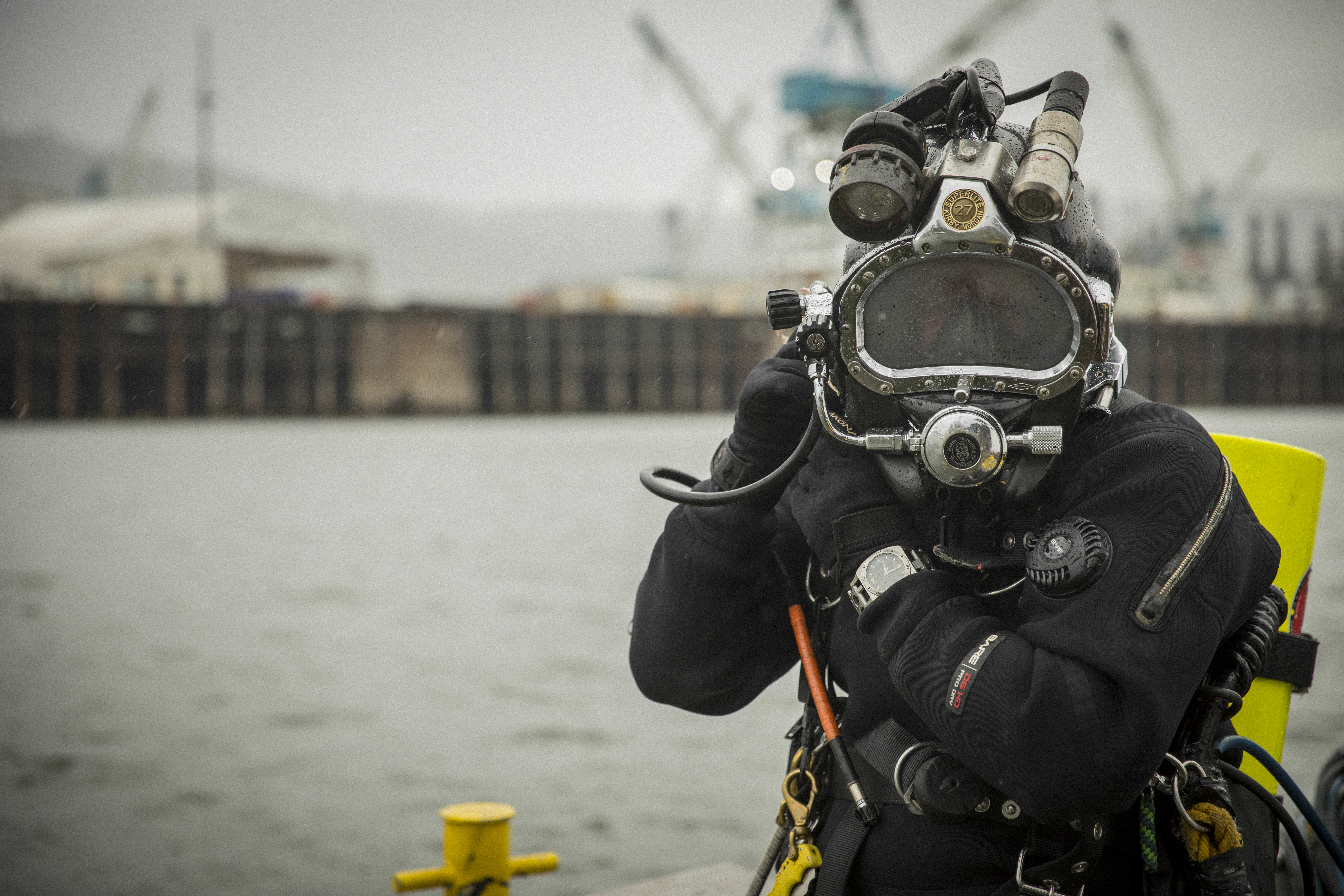 Scuba diver wearing Leatherman tread tempo multi-tool watch in silver