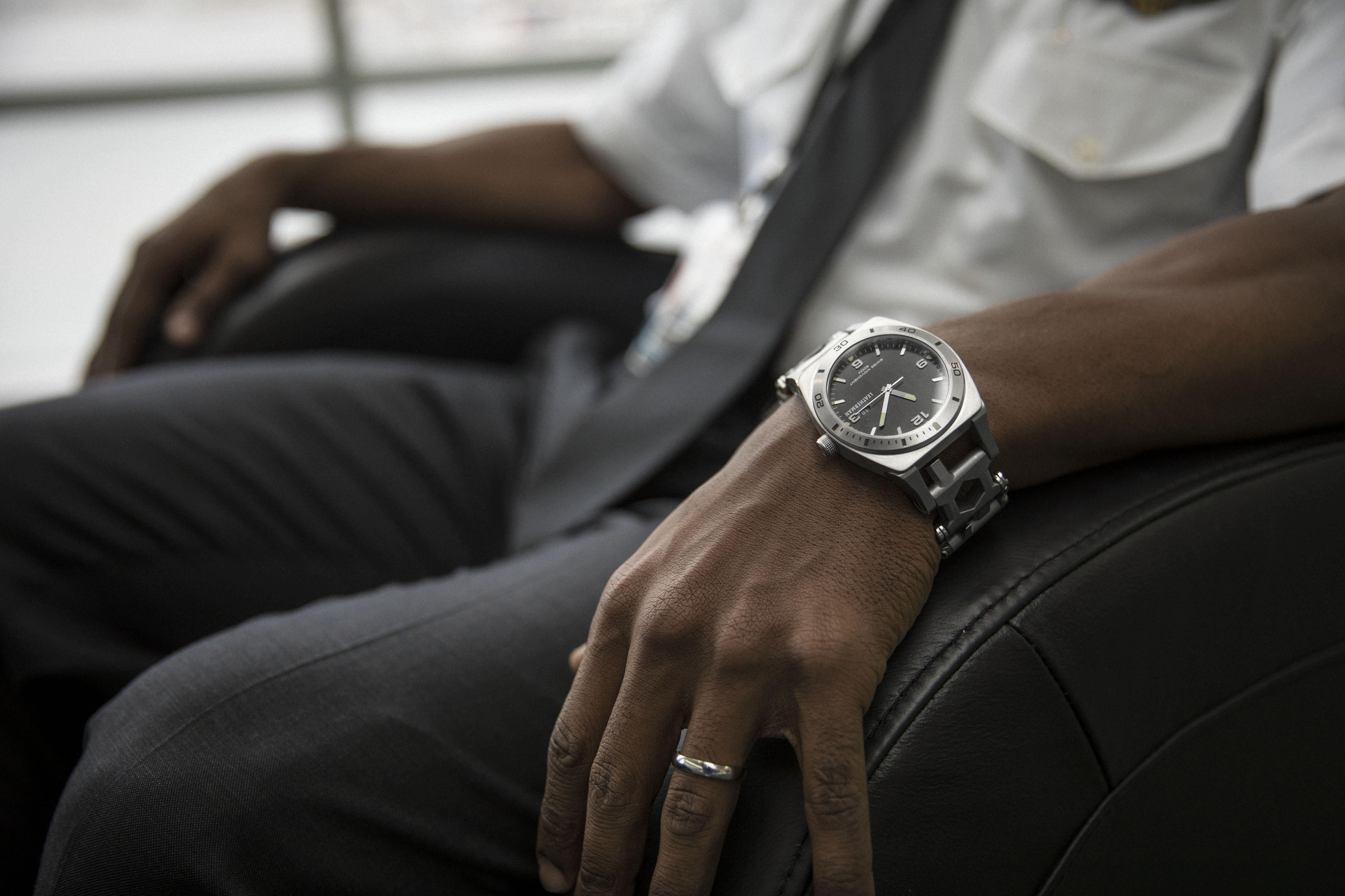 Leatherman tread tempo multi-tool watch on wrist, stainless steel